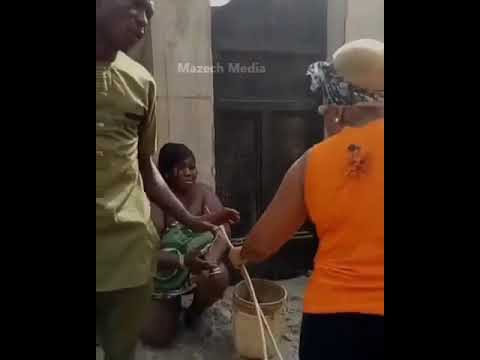 Part 1: Nigerian Lady Whips A Woman Caught Sleeping With Her Sister's Husband
