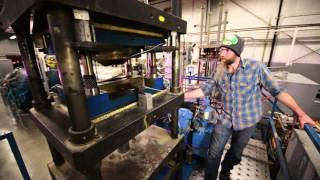 Compression molding presses and curing ovens at Kitsap Composites, Inc.