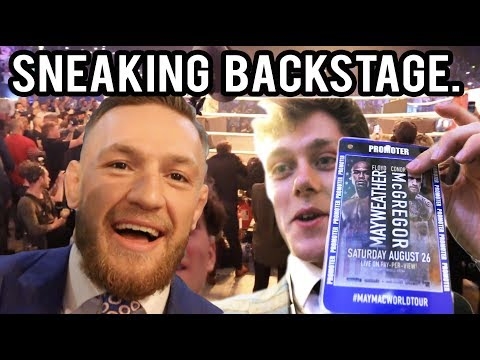 Guy sneaks backstage at McGregor vs Mayweather press conference in London and walks out with McGregor's team.