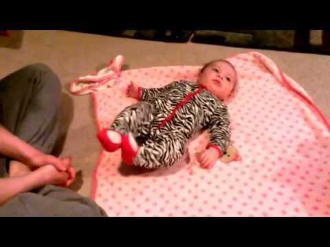 Baby rolling over first time. 3 1/2 months