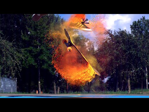 Beautiful Super Slow Motion Video of Skateboarders Riding Through Colourful Clouds of