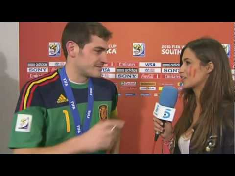 Casillas celebrates with a teary kiss on his girlfriend Sara (true love)