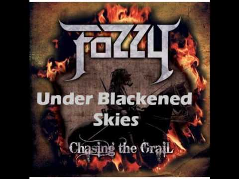 underblackened - Fozzy - Under Blackened Skies lyrics: All I ever knew When you left was suddenly taken My skies no longer blue And my faith mortally shaken Pain From my pore...
