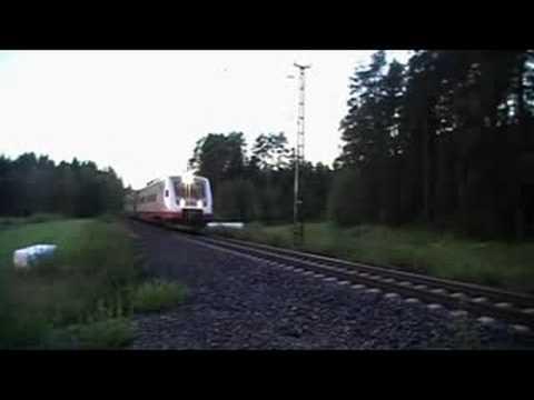 Pendolino 859 passes Suonperä level crossing