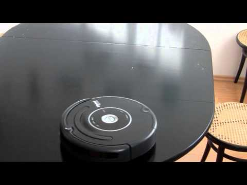 ROOMBA cleaning a table
