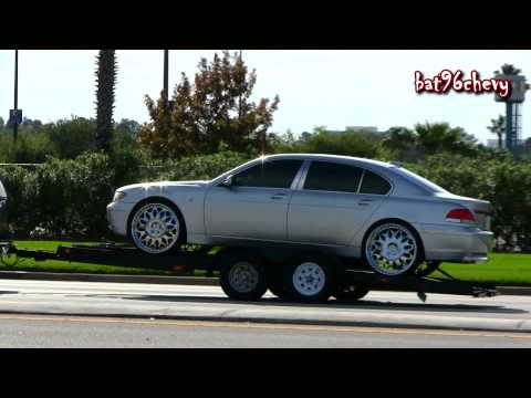 Tahoe on 26's towing a BMW 745 Li on 24