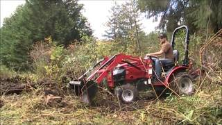 9. Mahindra Max  24, clearing  brush and other  shenanigans.