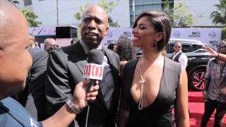 DJ Hustle Of HustleTV caught up with Kenny and his beautiful wife Gwendolyn Smith on the Red Carpet at the BET Awards.