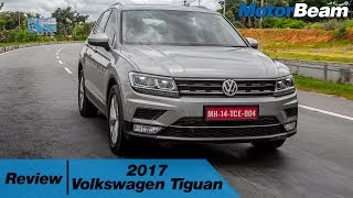 https://www.motorbeam.com tests the 2017 Volkswagen Tiguan. The Volkswagen Tiguan enters its second generation and the vehicle has been launched in India to mark Volkswagen's re-entry in the premium vehicle segment. The Tiguan is powered by a 2.0-litre TDI engine with a 7-speed DSG transmission and full time AWD. The Volkswagen Tiguan is a well-engineered product and carries a premium appeal. It competes in the Rs. 30-40 lakh SUV segment.Become a #MotorBeamer: https://goo.gl/LWPtmaFollow Us On:https://www.facebook.com/MotorBeamhttps://twitter.com/MotorBeamhttp://instagram.com/MotorBeamSnapchat - MotorBeamhttps://www.pinterest.com/motorbeamhttps://plus.google.com/+motorbeamhttps://www.motorbeam.com/Music Credits - 163cm Of Happiness By Muciojad - https://www.youtube.com/watch?v=0_yPetD5QrUStorm Time By Muciojad - https://www.youtube.com/watch?v=ehhtmyyD4DM