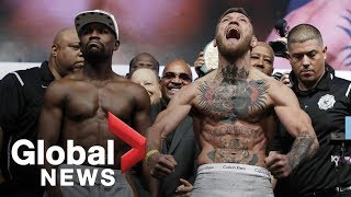 Video Floyd Mayweather vs. Conor McGregor weigh-in before superfight MP3, 3GP, MP4, WEBM, AVI, FLV Desember 2018