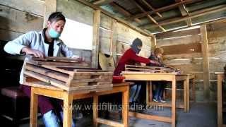 Sonam Tobden tends to his team at Lhawang Driden Incense as they prepare Drizang Kuenchap dhoop in Wangdue Phodrang...