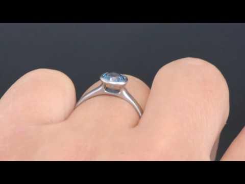 Precision cut blue Montana Sapphire Peekaboo Bezel Engagement Ring