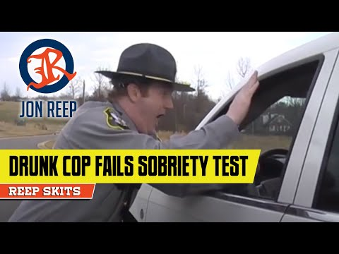 Drunk cop tries to pass a sobriety field test
