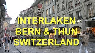 Please subscribe:  http://bit.ly/2pmdyeuSwitzerland playlist  http://bit.ly/2qsUism Interlaken in the heart of the Alps and Bern, at 8:42 are two of the great destinations of Switzerland presented in this practical guide, along with the historic city of Thun at 25:10 in the travel video. Interlaken makes a perfect home base for exploring the beautiful mountains all around the central region of Switzerland, offering many hotels, restaurants and shops, and wonderful train and bus connections to get up to the mountain sites. Tourists have been coming to Interlaken and the area since about 1800 when it was first popularized by some romantic painters and then tourism really increased in the 1890s and early 1900s with the opening of railway service. Some of the world's most spectacular mountain scenery is waiting for you just outside of Interlaken in the heart of the Swiss Alps. In this movie we're focusing on how to get the most out of your visit to the town. For the more adventurous you can go paragliding. Or for something less adventurous you can just rent a bicycle and go peddle around. There's a lot to see in the Interlaken area. The town itself is relatively flat and you can peddle through the shopping areas and up into the residential zones.A main activity in town is shopping – all sorts of souvenirs for sale, clothing, you can buy some hiking gear. It's a great place for backpacks, for boots, hats, clothing of all kinds, walking sticks and a T-shirt that says Interlaken.There's not much of a pedestrian zone that's free of automobiles here but they do have one little lane that's for pedestrians. But the rest of town is very friendly for walking around, the sidewalks are wide and there's always things to look at and things to do.The great meadow forms a major park, beautifully landscaped and kept in a semi-natural state with flowers and trees and the meadow along one side and grand hotels on the other.If you're a gambler there is a casino like there is in most Swiss