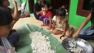 On the terrace of Mutia's family, one of the most popular meeting places for the children of the neighbourhood, a rice meal was served Sundanese style, called ...