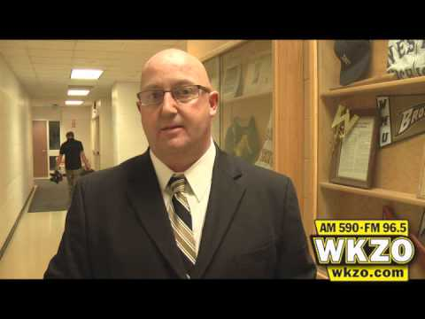 Head Coach Steve Hawkins talks with Carolyn Binder after WMU Basketball defeated Kent State 82-76 for their seventh straight win.