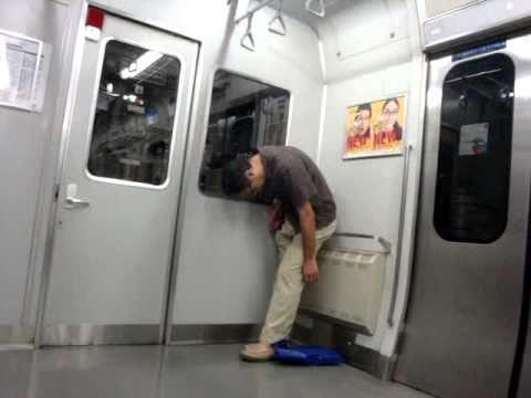 Japanese guy falls asleep standing up