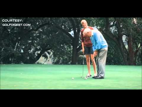 Kate Upton gives Arnold Palmer a golf lesson