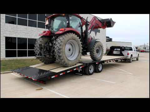 Gooseneck - Demo of a PJ 32 ft Low Profile Hydraulic Dovetail loading a Case IH Maxxum 115 tractor. This is the NUMBER ONE selling gooseneck hydraulic dovetail trailer i...