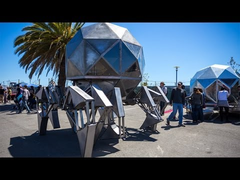 Giant Walking Pod Robot has roofmounted solar panel and wind