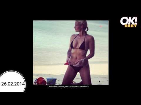 Sarah Connor halbnackt mit sexy Muckies im Mini-Bikini