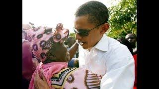 Former President Barack Obama dances with Mama Sarah Obama