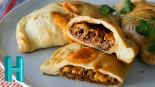 """Check out Hilah's Happy Hour - my new weekly podcast! http://vid.io/xca1Homemade Hot Pockets! These """"taco pockets"""" are perfect to make for a portable lunch. Bake a batch of hot pockets and freeze or refrigerate to reheat later. Subscribe to be notified when I release a new video! https://www.youtube.com/subscription_center?add_user=hilahcooking  MUSIC Credit: """"Gravy"""" by Podington Bear http://www.podingtonbear.com/about/Check out all my video recipes:https://www.youtube.com/user/hilahcookingPrintable Homemade Hot Pockets Recipe: http://hilahcooking.com/homemade-hot-pockets/Ingredients:Dough:1/4 ounce yeast1 1/4 cups warm water (100-110ºF)1 teaspoon sugar1 teaspoon salt3 cups bread flourfew drops oilFilling:1 teaspoon oil1 cup diced onion1 clove garlic, minced2 teaspoons chili powder1 teaspoon ground cumin1/2 pound lean ground beef1/2 teaspoon salt1/2 teaspoon pepper1/4 cup salsa1 cup refried beans4 ounces cheese, cut into 8 slicesMy cookbooks and classes https://hilahcooking.mykajabi.com/Facebook : http://www.facebook.com/hilahcooking Twitter : http://twitter.com/hilahcooking Pinterest: http://pinterest.com/hilahcooking/Instagram: http://instagram.com/hilahcookingHilah Cooking is a short-form, educational web cooking show focused on making cooking FUN! I show you simple, low-cost recipes with a Texas flair. Everything from how to make tortillas, to churros, to how to poach an egg. Basic cooking techniques and delicious home cooking recipes. New videos every Thursday!For over 450 video recipes and contact information, visit http://hilahcooking.com"""
