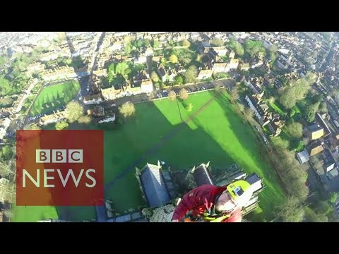 At - Cathedral conservators who scaled the height of Britain's tallest spire to repair a weather meter have filmed their spectacular efforts. Clerk of Works Gary Price led the