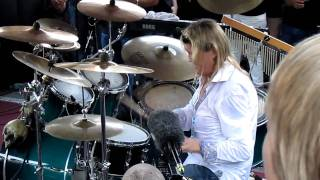 "Iron Maiden's drummer Nicko McBrain performing song ""Run To The Hills"" live at pre-concert part @ his restaurant Rock N Roll ..."