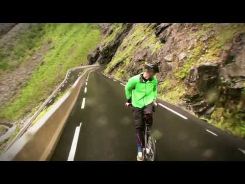 Fearless guy rides bike backwards down mountain.