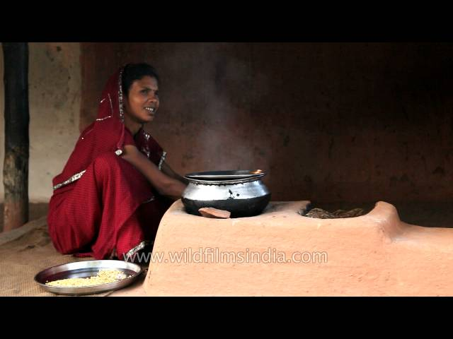 Indian-woman-cooks-food-on