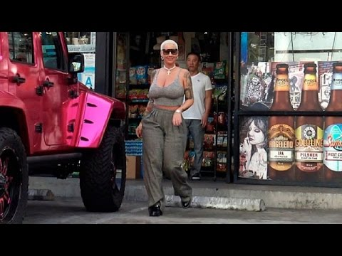 Amber Rose Flaunts Massive Cleavage In Tiny Tank