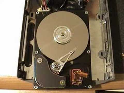 HDD - Simple operations performed by a hard drive with no cover, so that you can see what it looks like inside. This experiment was performed on an old hard drive,...