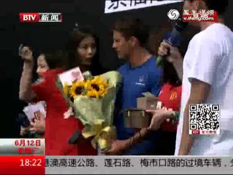 bejing - Michael Owen talks to a Chinese News Station on his arrival in Bejing for his 4 day tour sponsored by SoccerWorld Note: Audio in Chinese apart from Michael O...