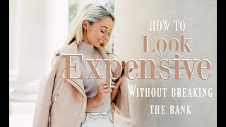 HOW TO LOOK MORE EXPENSIVE - Get a Luxury Looking wardrobe with affordable highstreet pieces - here are my ten tips! Pieces mentioned linked below!Subscribe so you don't miss any videos :) http://bit.ly/1zG3soB________________________________________­___________________ ❤ Featured in this Video ❤White dress - http://bit.ly/2r6h8GL Pink blouse - http://bit.ly/2tWyJp2 Ring - http://bit.ly/2i7GCSCGold Bracelet - http://bit.ly/2iEFfrn Gold Cuff - http://bit.ly/2nEVk2x Sunglasses - http://bit.ly/2tD7ZYr Cut out sunglasses - http://bit.ly/1JjABeM Valentino bag - http://bit.ly/2caFfyK Pink Valentino heels - http://bit.ly/2cWFZLt Gold Valentino heels - http://bit.ly/2nPdPW1 Pearl flats - http://bit.ly/2rvyAbc White mules - http://bit.ly/2rRO7kP Sally Hansen nail polish in shade 'powder room' - http://bit.ly/2sU4tf4 Bobble off - http://bit.ly/2sDW5fB Lint Roller - http://bit.ly/2sDTja5 Trench coat - http://bit.ly/2pVLQED Suede jacket - http://bit.ly/2sDFaux fur mules - http://bit.ly/2sDBoQL White sandals - http://bit.ly/2tnggBYPink Espadrilles - http://bit.ly/2stcl6lPink and black block heel sandals - http://bit.ly/2qVZJRa White chain bag - http://bit.ly/2sDRxFH________________________________________­___________________ ❤ What I Wore ❤White blouse - http://bit.ly/2q8mq53 Plisse culottes - http://bit.ly/2qswowN Earrings : http://bit.ly/2ssynTHNecklace : http://bit.ly/2mx7AVuRing : http://bit.ly/2i7GCSCBracelet : http://bit.ly/2 ________________________________________­___________________ WHERE ELSE TO FIND ME!❤ Blog // http://www.fashionmumblr.com❤ Instagram // https://instagram.com/josieldn/❤ Twitter // https://twitter.com/FashionMumblr❤ Bloglovin // http://bit.ly/1QgW457❤ Facebook // https://www.facebook.com/fashionmumblr❤ Snapchat // JosieLDN________________________________________­___________________ ❤ Get in touch with me here: http://bit.ly/1QCe5xe❤ Filming & Photography Information : http://bit.ly/1K3yPxa❤ How I get my hair colour with L'Oreal Professional :http://bit.ly/2rp5VBI ________________________________________­___________________ ❤  In the Background:Copper clothes rail - http://bit.ly/2tWFirI Copper hangers - http://bit.ly/2uFqP18 ________________________________________­___________________ Popular Blog Posts:❤ FAQs ft How to Start a Blog : http://bit.ly/2eowZPH❤ Life as a full time blogger / YouTuber : goo.gl/Y1ceLq❤ Why Every Twenty-Something should Practise Mindfulness : http://bit.ly/2eLr6I6________________________________________­___________________NB : The links above are likely to be affiliate links, which means if I have inspired you to make a purchase and you choose to buy something through one of these links, I may receive a small commission on the sale, as a way of thanks! It makes no difference to you as a buyer at all but I may receive a small compensation from the brand via rewardStyle. If you'd like to find out more, you may like to read this post : http://bit.ly/2rjaGPU xoxo