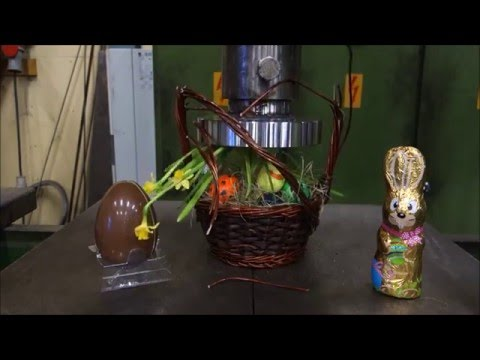 Crushing a Festive Easter Basket Chocolate Bunny and a Chocolate Egg With a Hydraulic