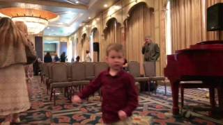 Landyn Walks (Jumps) Through the Hall After Feast Services