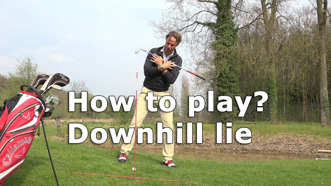 How to play a golfball in a downhill lie?