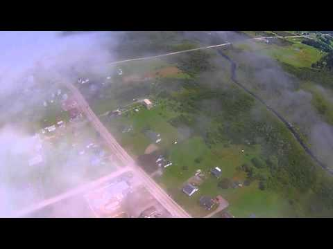 Flying above the fog in Comeauville, Nova Scotia. Nice aerial view of the crest of the fog bank.