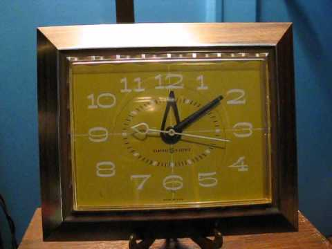Late 1960s General Electric Wall Clock - Faux Wood (Plastic) Case, Harvest Gold Face