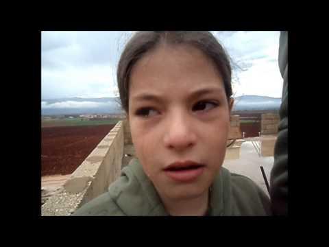 طفلان من داريا تسبقهما دموعهما