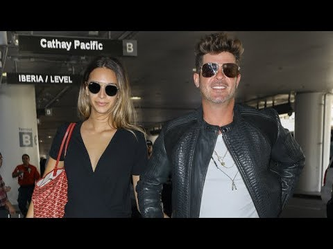 Robin Thicke And Pregnant GF April Love Keep The Baby's Gender Secret At LAX