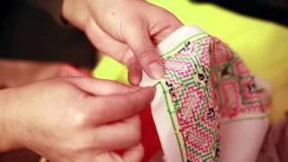 How to knot a Paj Ntaub thread