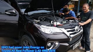 "Saving fuel ""Joko Energy Indonesia"" on Toyota Fortuner 2400cc Diesel 4WD 2016 using HHO reactor which decompose water (H2O) into HHO or oxyhydrogen gas.Hydrogen gas to raise the octane / cetane quality so that more fuel is more powerful engine.Oxygen gas to enhance the internal combustion engine making it more efficient and more environmentally friendly.Saving fuel can be used for all vehicles that use petrol, diesel and gas.___Penghemat bbm ""Joko Energy Indonesia"" pada Toyota Fortuner 2400cc Diesel 4WD 2016 menggunakan reaktor HHO Model: JE5000s yang menguraikan air (H2O) menjadi gas HHO atau OxyHydrogen.Gas Hidrogen untuk menaikan oktan/cetane agar bbm lebih berkualitas sehingga mesin kendaraan lebih bertenaga.Gas Oksigen untuk menyempurnakan pembakaran internal mesin sehingga lebih hemat dan lebih ramah lingkungan.Penghemat bbm ini bisa digunakan untuk semua kendaran yang menggunakan bahan bakar: bensin, solar dan gas.#jokoenergy#penghematbbm#fuelsaver#HHO#oxyhydrogen#bahanbakarair#pengiritbbm#pengiritsolar#pengiritbensin#penghematbensin#penghematsolar#ramahlingkungan#mobilbaru#toyota#astra#indonesia#jokoenergyindonesia#hhoindonesia#jokoenergycommunity#beritaterkini#cleaningengine"