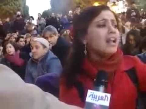 Tunisian Girl Sings during demonstration - Amal Mathluthi