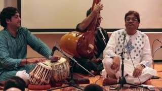 "Ustad Mashkoor Ali Khan: Raga Dhani. Bandish in Addha tal: Mori baiyaan na pakado giridhar shyamLive recording of a concert hosted by Raga Music Circle in New York on June 12th 2016Khan sahib's comments in the beginning: ""I am going to present a couple of bandishes in raga Dhani. The first one is by Sanad Piya, who was the court musician of Wajid Ali Shah (the last Nawab of Awadh). His court had many of the great composers of the time like Sanad Piya, Kadar Piya, Lalan Piya, Aish Piya...a lot of piyas (lovers). Wajid Ali himself composed as Akhtar Piya. This composition is very beautiful in its use of poetry and presentation of the words.""Khan sahib goes on to demonstrate ""bol banao"" throughout his rendition. The same phrase being musically improvised and presented in many different ways, all within the raga, to bring out the depth of its meaning and emotions.Tabla: Nitin MittaHarmonium: Anirban ChakrabartyTanpuras: Anup Barua and Michael HarrisonRecorded and edited by Aric Gutnick"