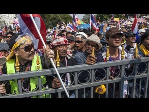 minister - Thailand's prime minister dissolves parliament but street unrest continues Subscribe to the Guardian HERE: http://bitly.com/UvkFpD Thailand's prime minister ...