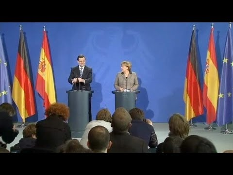 Slush fund scandal follows Spain's Rajoy to Berlin