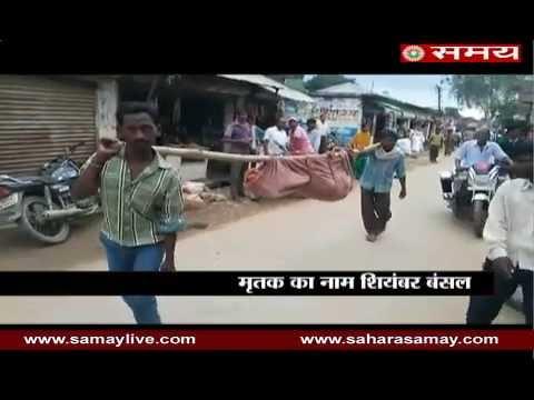 Family members of deceased on shoulder to hospital for post-mortem