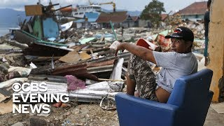 Video 1-year-old girl found alive under debris from tsunami in Indonesia MP3, 3GP, MP4, WEBM, AVI, FLV Desember 2018